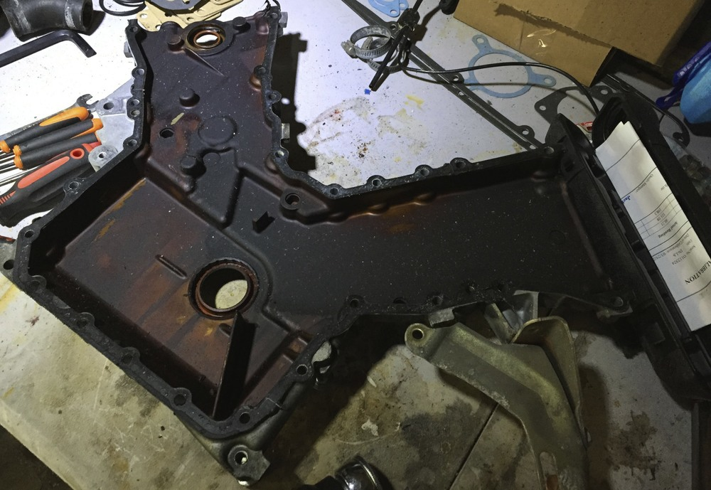 The timing cover before removing the gasket.