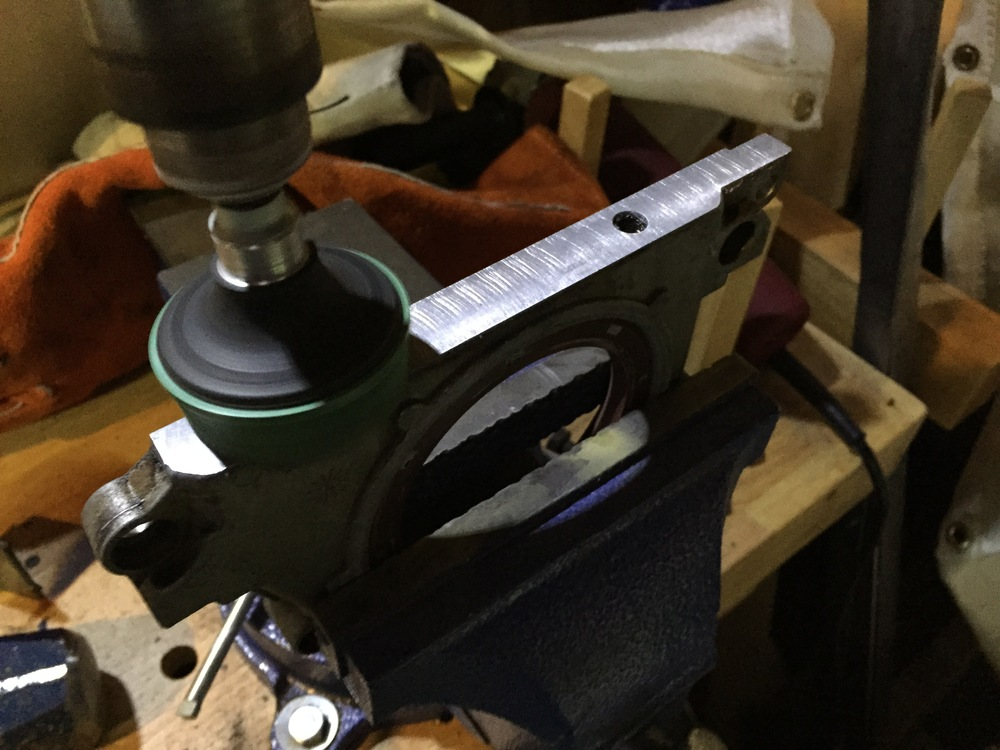 Using a bristle disc on a power drill to clean the horizontal surface of the plate.