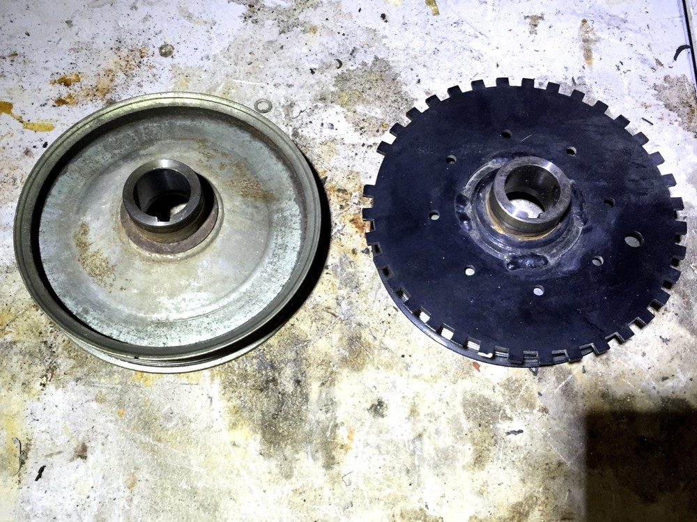 The back of the original pulley (left) and modified pulley (right)
