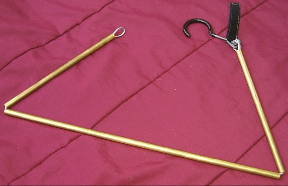 Although not necessary for normal use, the hanger can be disassembled by pulling the loop over the hook.  This more clearly shows the construction of the hanger.