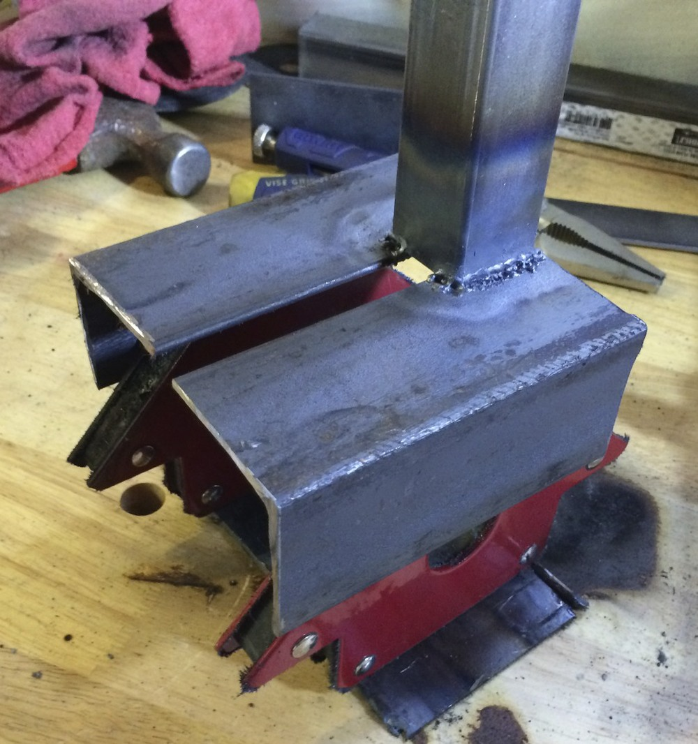 The spine welded to the cradle, using a frame of magnets to keep everything together during welding.