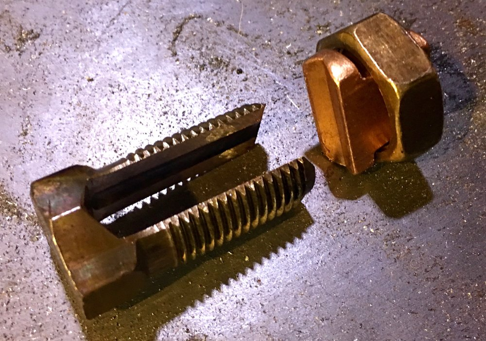An example of a split bolt.  The split slides over the wire, and the nut twists on to clamp the wire in place.