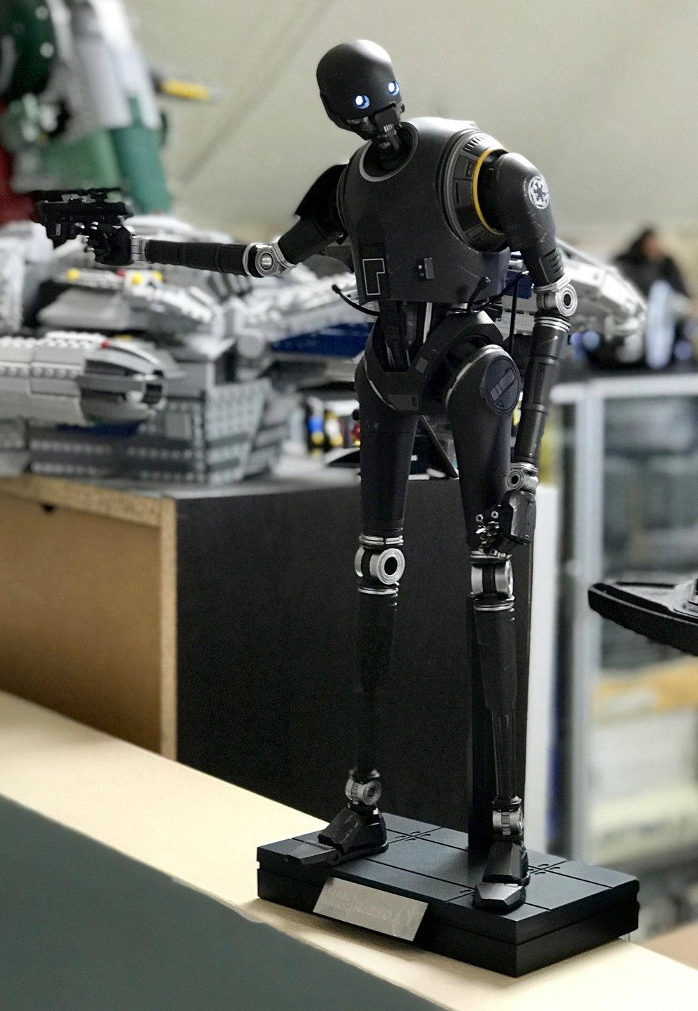 K-2S0, with LEGO Firefly Serenity and LEGO Slave 1 in the background