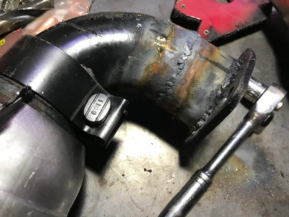 After cutting out a wedge and welding the pipe back together for a proper fit.