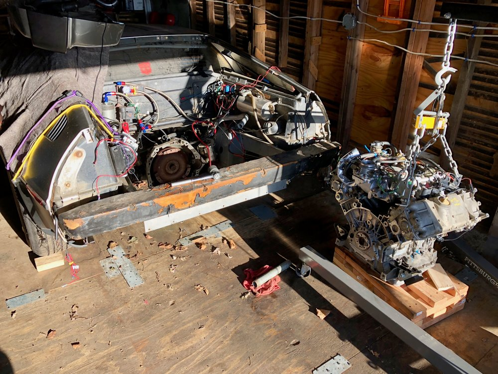 The engine fully removed from he car, temporarily resting on some pallets while we get the engine stand set up.