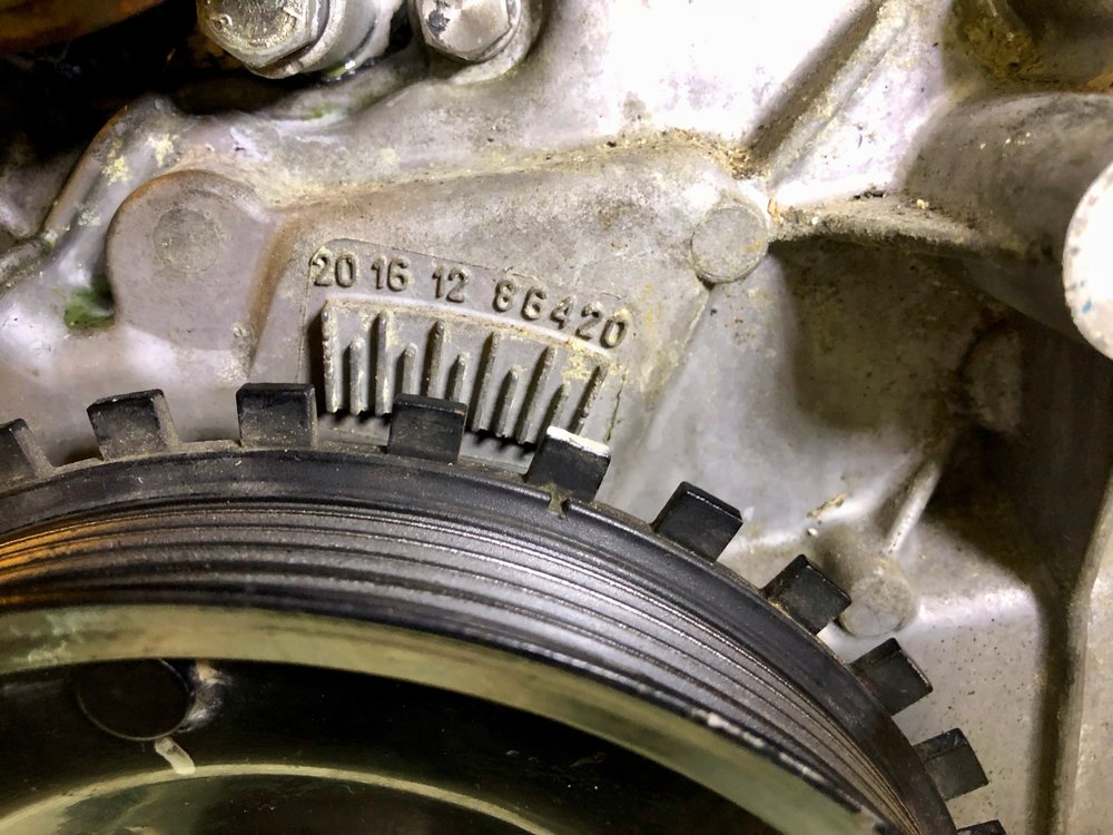 The mark on the crank pulley lined up to 0 degrees on the timing plate.