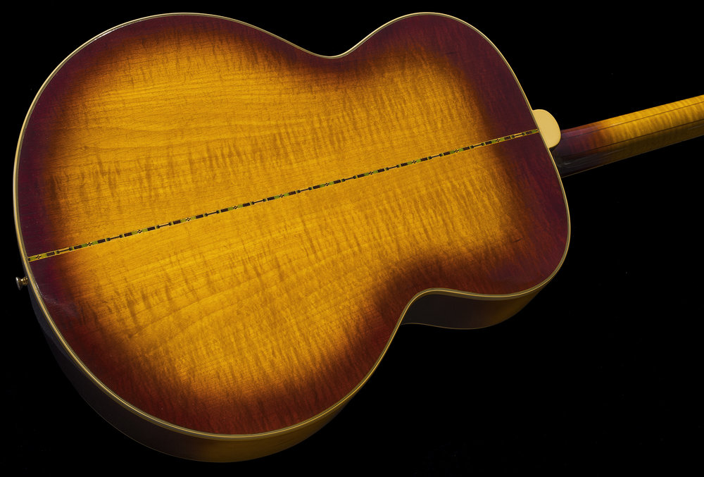 direct sunlight better reveals the figuring of the maple body and neck!