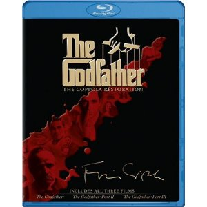 "NOTE: Merlin's actual Wish List includes the VHS version of the Complete Godfather Series. While that version is available used, I'm going out on a limb and putting the new Bluray edition up here. The Godfather Collection (The Coppola Restoration) [Blu-ray] (2008) $36.12  Special Features Featurette: ""The Masterpiece That Almost Wasn't"" Featurette: ""Godfather World"" Featurette: ""Emulsional Rescue: Revealing 'The Godfather'"" Featurette: ""….And When the Shooting Stopped"" The Family Tree/The Crime Organization Montage: ""'The Godfather' on the Red Carpet"" Four Short Films on 'The Godfather' Audio Commentaries Documentary: ""The Godfather Family"" ""Behind the Scenes"" Featurettes Storyboards Additional Scenes/Historical Timeline"