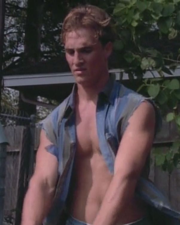 A shirtless 23-year-old McConaughey mows the lawn