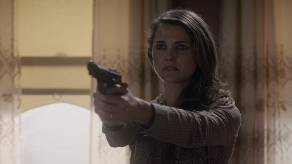 Maybe the first time we've seen Elizabeth unsure about pointing a gun at someone