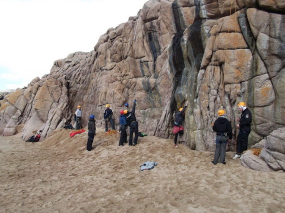 Group prepare for rock climb on Cruit island