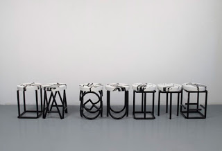 Just like an ant walking on the edge of the visible , 2009. 41 wood-and-metal stools painted with silk-screened graphics
