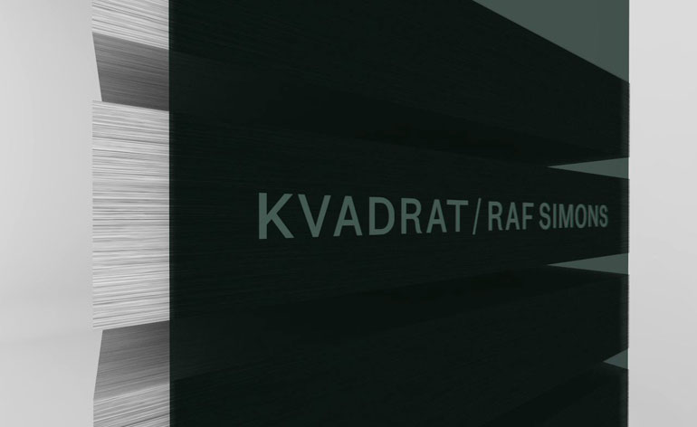 A detail of the cabinet shows the Raf Simons for Kvadrat identity, by Graphic Thought Facility with Peter Saville
