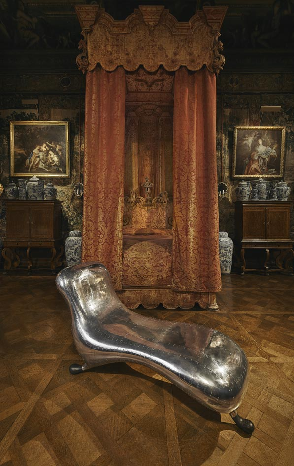 A prototype of Marc Newson's Lockheed Lounge is displayed alongside a state bed dating back to 1810