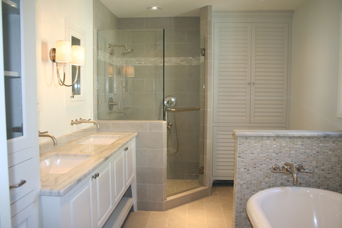 The Finished Bathroom Included A Free Standing Tub Toilet Corner Shower Double Vanity Full Size Linen Cabinet With Laundry Pull Outs And