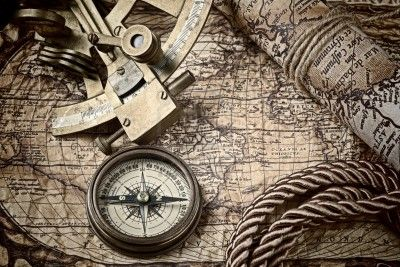 18232883-vintage-still-life-with-compass-sextant-and-old-map.jpg