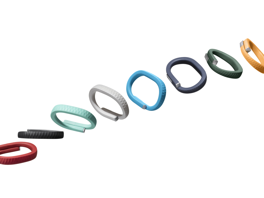A promotional image from Jawbone featuring the Up band in various colors.