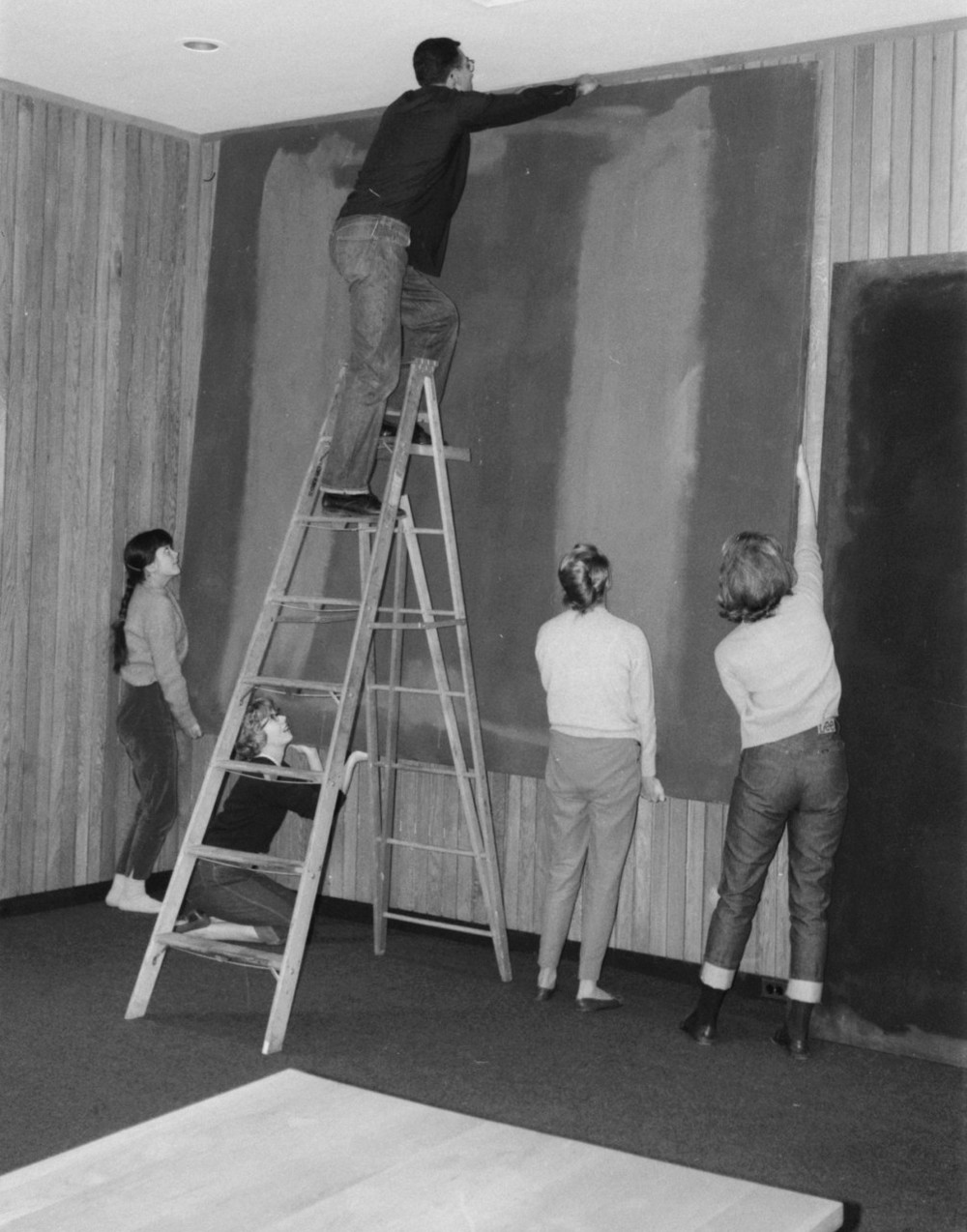 Students assisting with the hanging of Panel 1