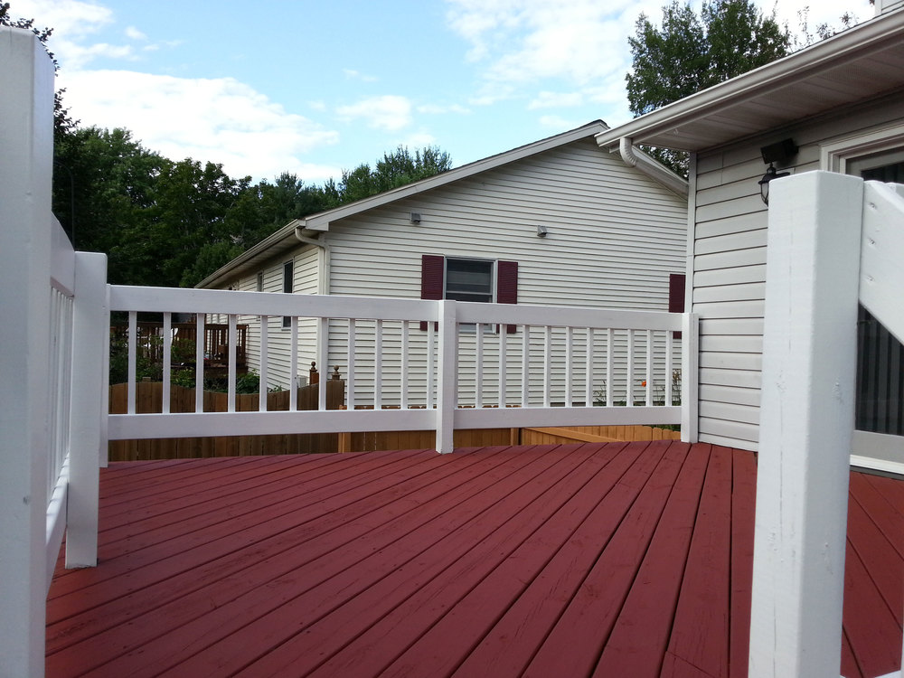 Protect your deck from the harsh Wisconsin weather call Megna Painting.