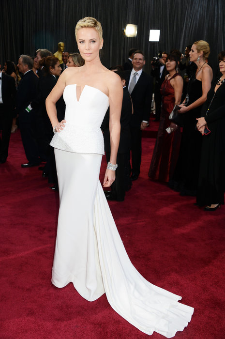 Charlize Theron, no one else can pull off short hair and such a dramatic gown. Beautiful