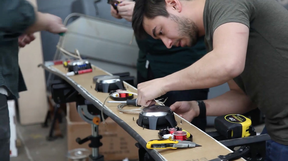 guy building audio speakers board.jpg