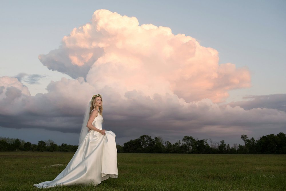 Nature was showing off at the end of this bridal session at Oak Hollow Farm.  Bridal Gown is from Bliss Bridal in Fairhope, AL