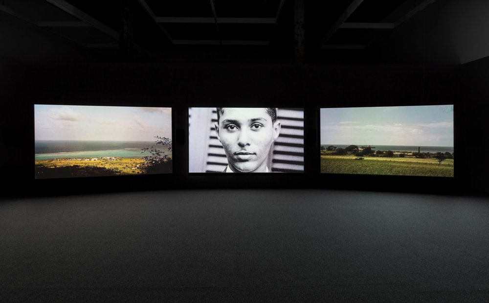 John Akomfrah, The Unfinished Conversation (video still), 2012. Installation view, The Power Plant, Toronto, 2015, in partnership with Autograph ABP, London. Courtesy the artist; Smoking Dogs Films; Lisson Gallery. Photo: Toni Hafkenscheid.