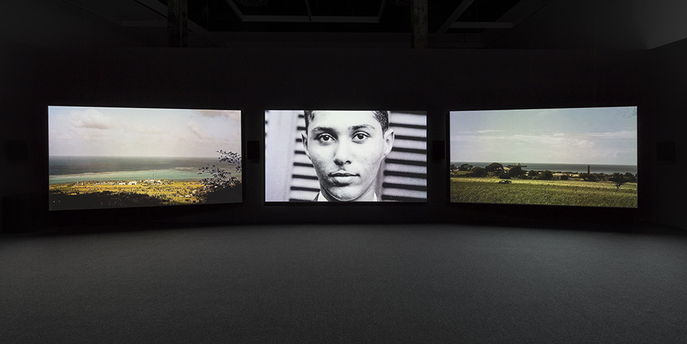 In Winter 2015, The Power Plant presented  The Unfinished Conversation  , an exhibition which took as its point of departure the work of cultural theorist Stuart Hall, who devoted his life to studying the interweaving threads of culture, power, politics and history. Featuring the work of artists Terry Adkins, John Akomfrah, Sven Augustijnen, Steve McQueen, Shelagh Keeley, and Zineb Sedira, the exhibition invites viewers to consider how meaning is constructed; how it is systematically distorted by audience reception; and how it can be detached and drained of its original intent to produce specific or slanted narratives. This exhibition was previously on view at Museu Coleção Berardo, Lisbon, Portugal from 21 September - 31 December 2016.