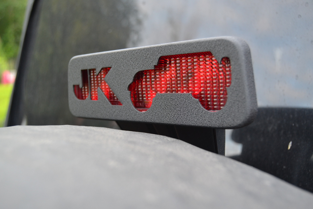 BLACK JK (2007-PRESENT) THIRD BRAKE LIGHT GUARD SHOWN ABOVE. ORIGINAL DESIGN.