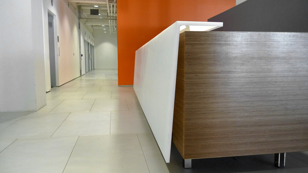 Buro Happold  Reception desk  Custom resin panel, bamboo and stainless steel