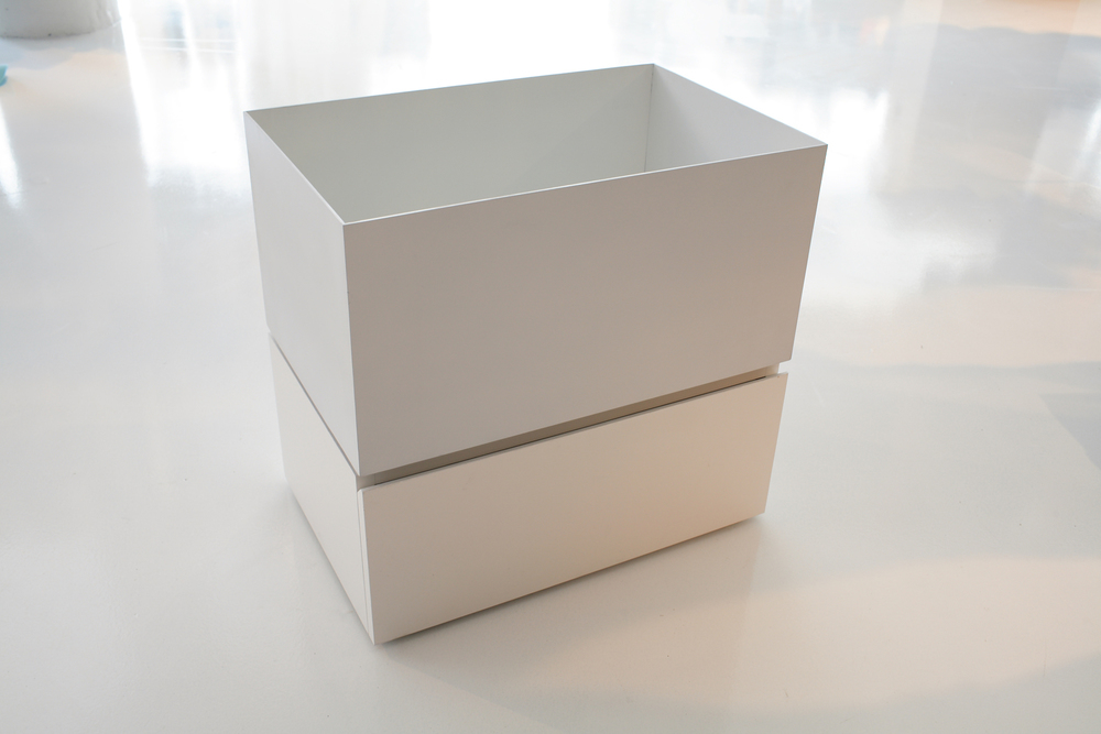 Hugo Boss  Custom aluminum containers with a powder coated finish