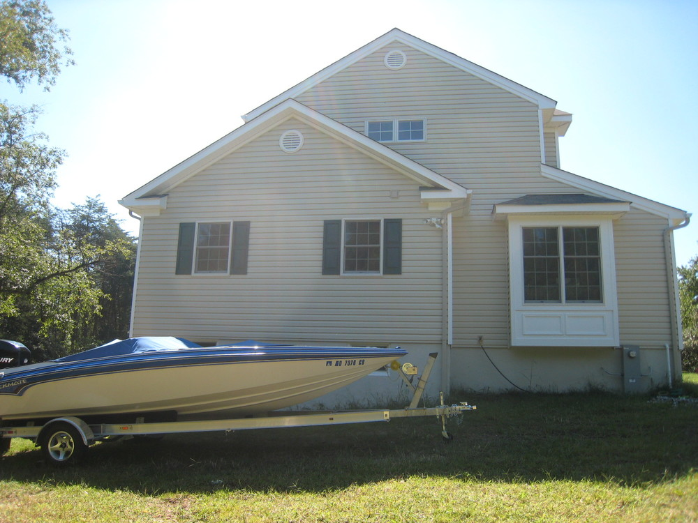 After: the owners' boat now fits in the basement level storage bay, accessible from the rear.
