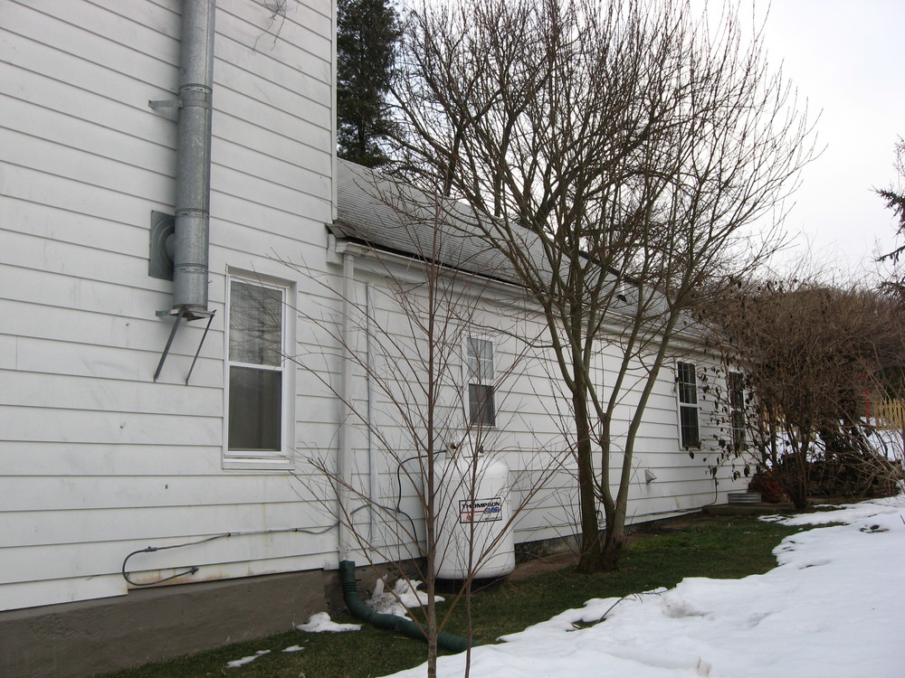 Before:  the right elevation.  The middle addition will be torn down and replaced with a two-story addition.