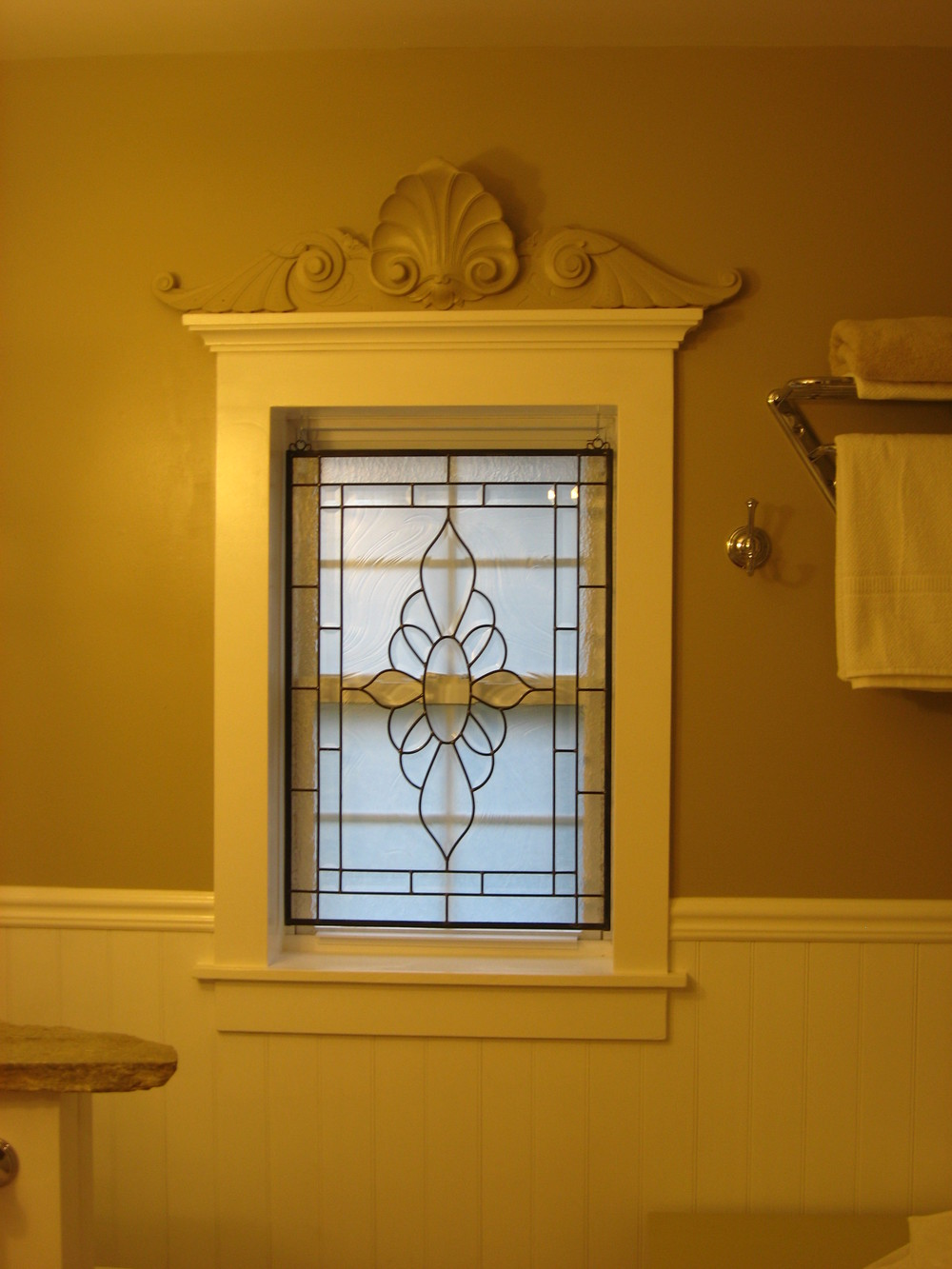 After:  the homeowner really made this double-hung window into something special with his leaded glass and his millwork.