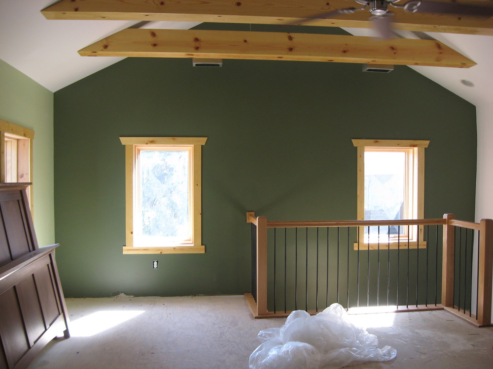 During:  in the existing log section of the home, the walls have been lengthened and the collar ties lifted up too, so the owners have a larger-feeling room even though the floor space hasn't changed.