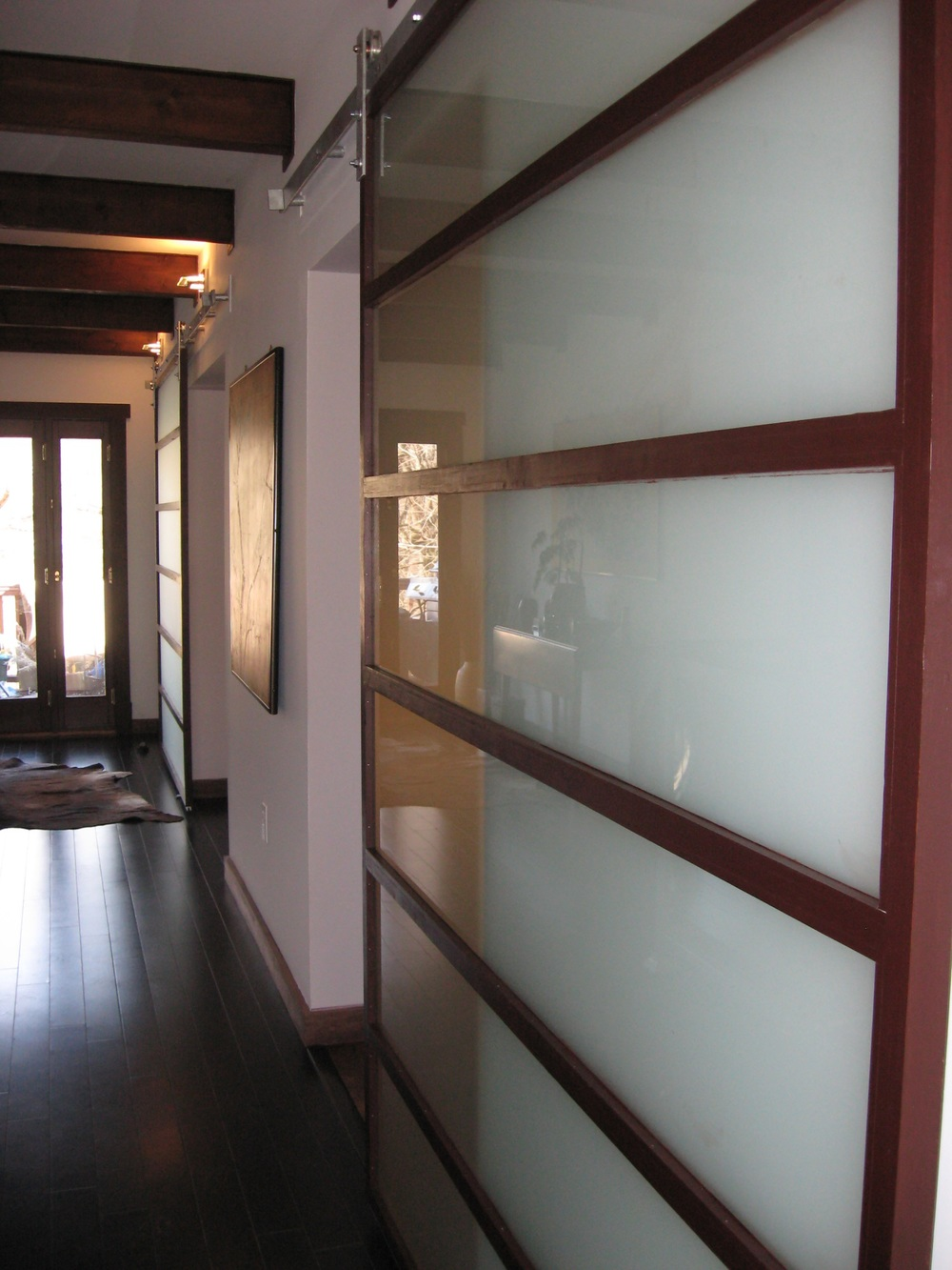 At the back of the foyer hall is another door leading out to an existing deck.
