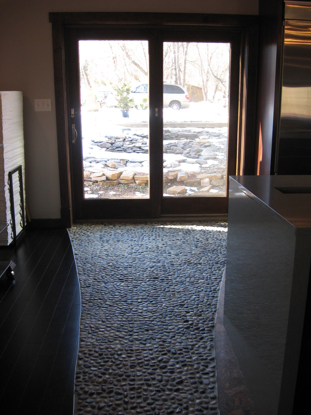 Since these photos were taken, a large pond and landscaping have been installed beyond the doors.