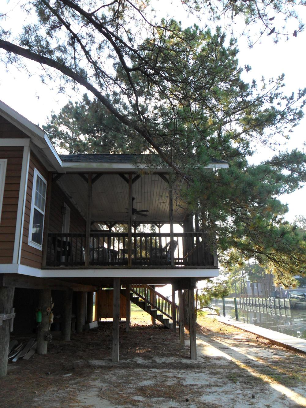 The screened porch is accessible from the deck and from the master bedroom.