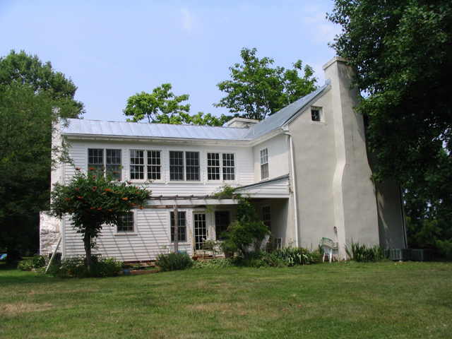 After:  the owner wanted the second story to look like it was originally a covered porch that had been enclosed, with windows filling in the spaces between original porch posts.  The twin windows on the left are in a new bathroom; the other three sets are in a sunroom accessible from the original and more recent second story wings.