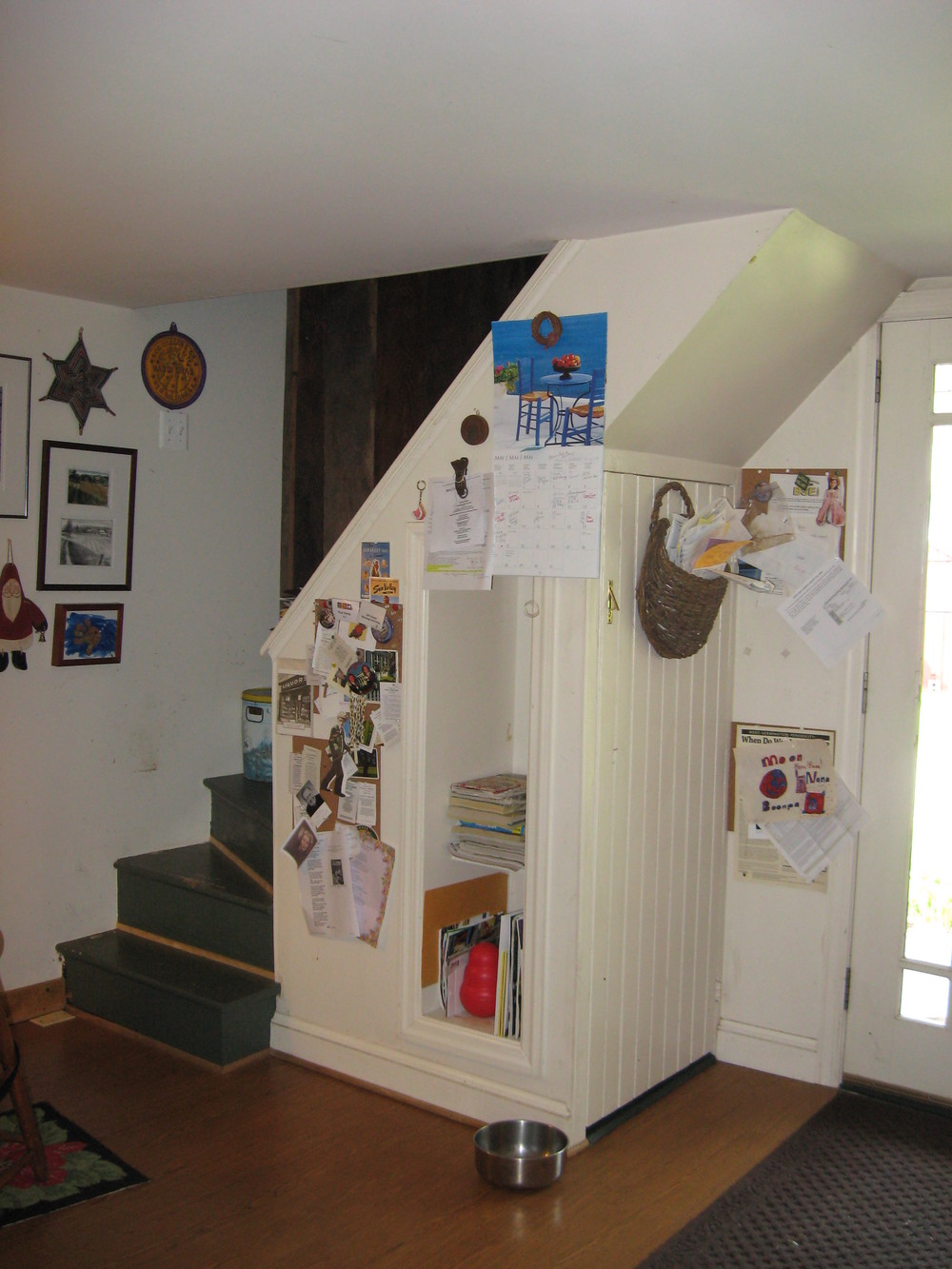 "Before:   there was a tiny ""back stair"" in the original kitchen, used only by the cat. I recommended removing it entirely to make the kitchen larger, then shifting the exterior door a few feet into that corner to make the working area of the kitchen larger.  But what to do about the cat and her ""secret passageway""?"