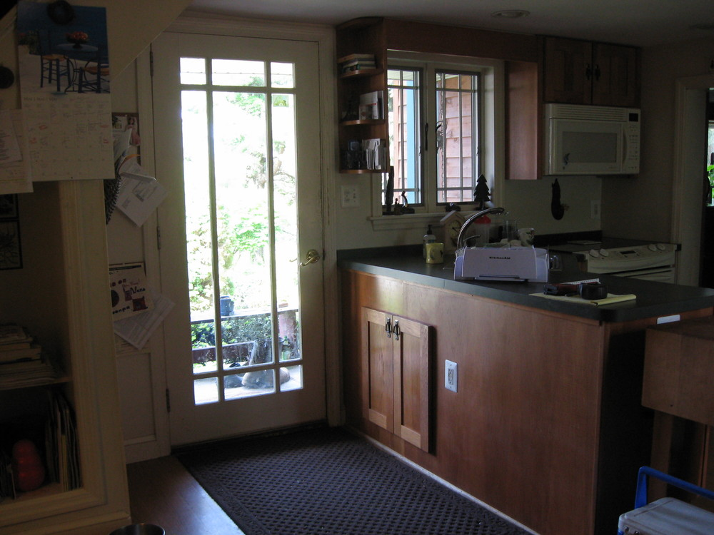 Before:Just not enough space or natural light in this tiny kitchen!