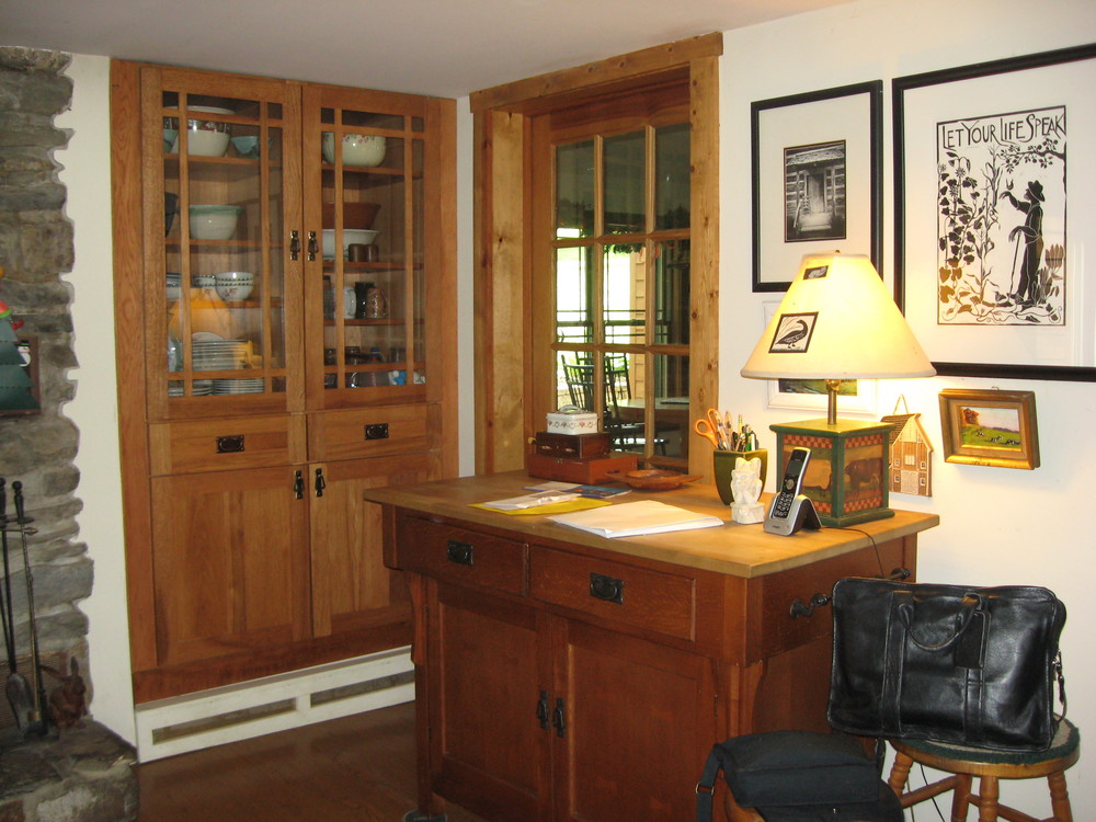 Before:  the corner of the existing kitchen contains a built-in china cabinet, perpendicular to the door leading into the existing dining room.  The client wished to have built-in base cabinets to the right of this door instead of the free-standing furniture.