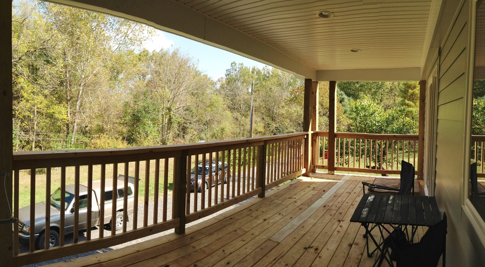 After:  new covered porch is shared by the master bedroom and the new dining area.