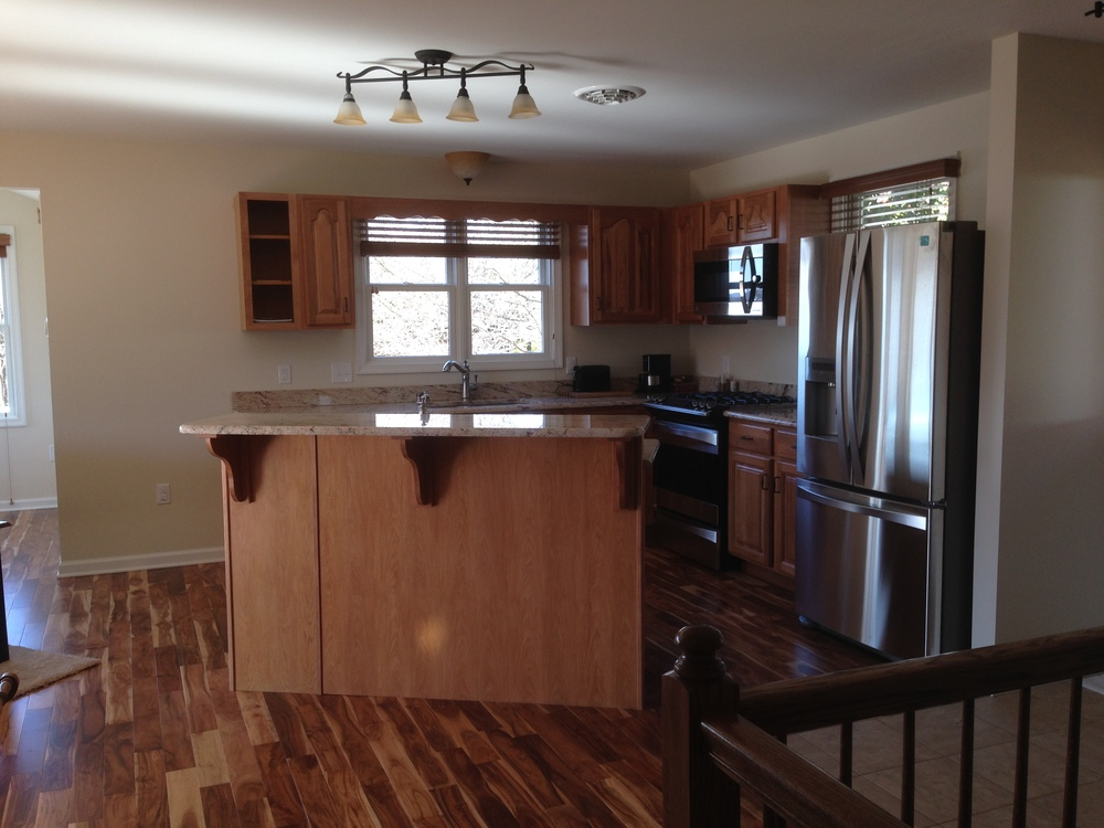 AFTER:  The remodeled kitchen in the same location.  Sink window was removed and replaced with a larger unit.
