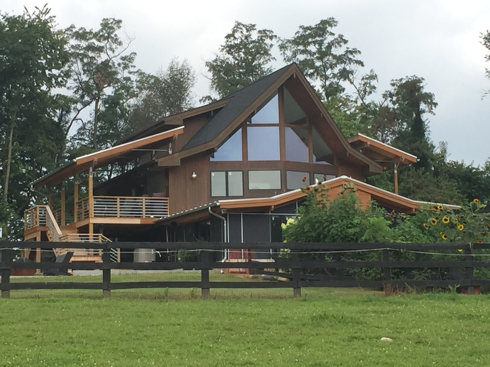 Contemporary additions to post and beam prow home fine for Roof addition