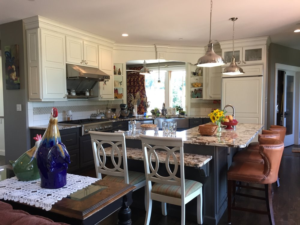 The pass-through over the kitchen sink allows a view to the driveway beyond, provides additional natural light, and nicely connects the kitchen to the breakfast nook.