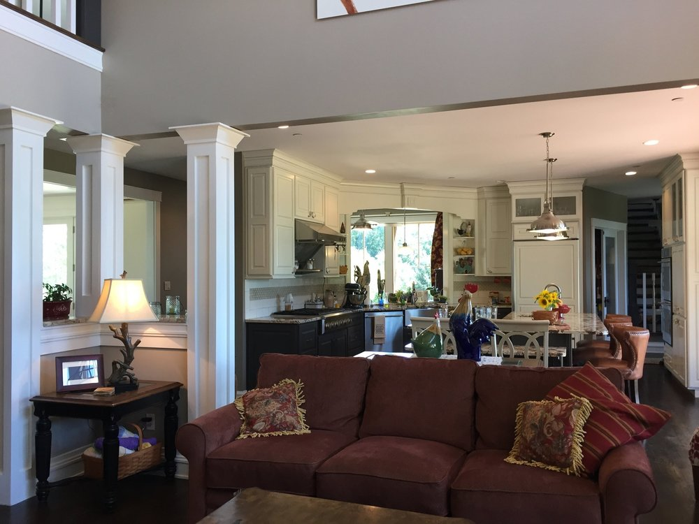 The two-story living room is open to large yet practically laid-out kitchen beyond.