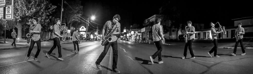 Tenor saxophonist Stan Killian dancing and playing in front of the Faust Hotel in New Braunfels, TX.