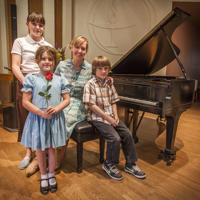 Patches with Lila, Ada, and Andrew Johnson after a piano recital by her students in 2013.  Their dad owns the farm where I work as photographer.