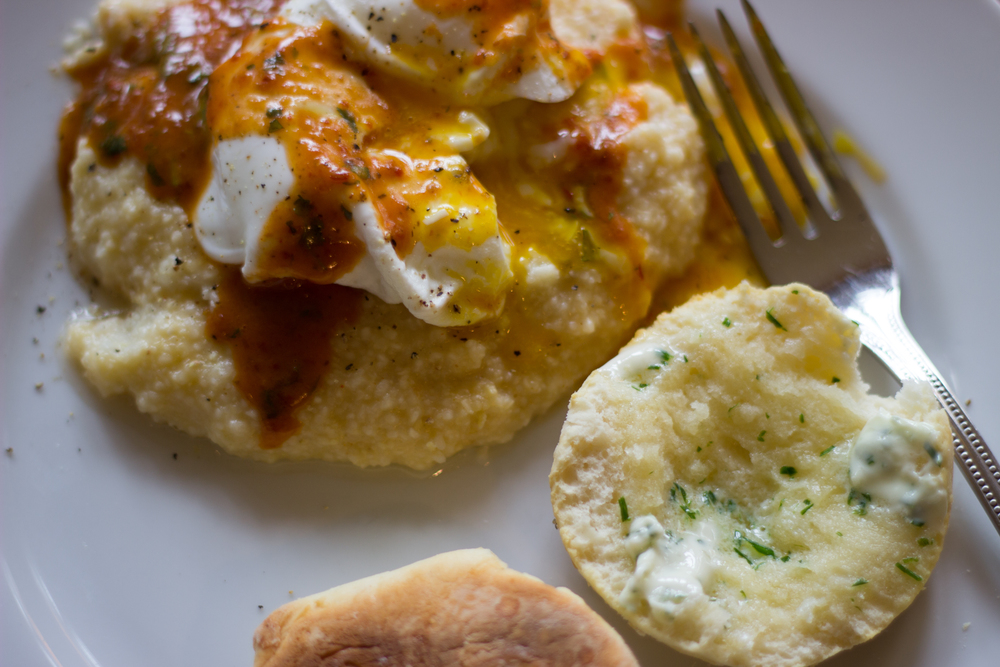cheese grits topped with a poached egg and drizzled with chipotle sauce (recipe to come in the near future) + buttermilk biscuits with chive butter